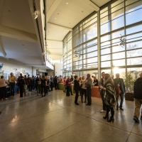 People at an event in the atrium of the CIA at Copia in Napa, CA.