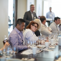 People attending a wine tasting class in a private dining room at the CIA at Copia in Napa, CA.