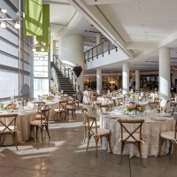 Tables set for a wedding in the Atrium of the CIA at Copia in Napa, CA.