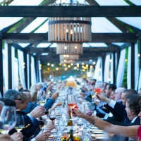 People making a toast at an event on the Herb Terrace of The Culinary Institute of America at Greystone in St. Helena, CA.