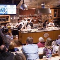 Cooking demonstration at the De Baun Theatre, a theater-style venue with a demonstration kitchen on the campus of The Culinary Institute of America at Greystone in St. Helena, CA.