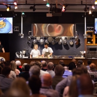 People watching a cooking demonstration at the Ventura Foods Center on the campus of The Culinary Institute of America at Greystone in St. Helena, CA.