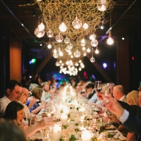 People enjoying dinner in the Barrel Room wedding venue at The Culinary Institute of America at Greystone in St. Helena, CA.
