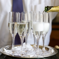 Opening and pouring champagne. From Chapter 9, Beverages, of Entertaining: Recipes and Inspirations for Gathering with Family and Friends.