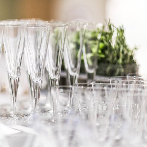 Empty champagne glasses in preparation for an event at one of The Culinary Institute of America's many event venues.