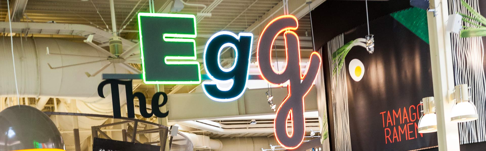 Colorful logo of The Egg