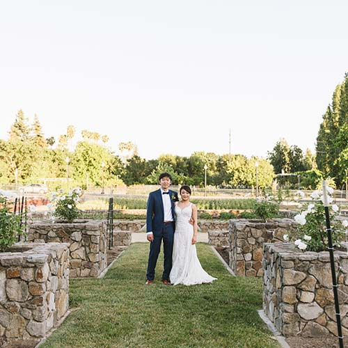 Wedding couple in the Copia Culinary Gardens, a picturesque space for a wedding ceremony, reception, or dinner at the CIA at Copia in Napa, CA.