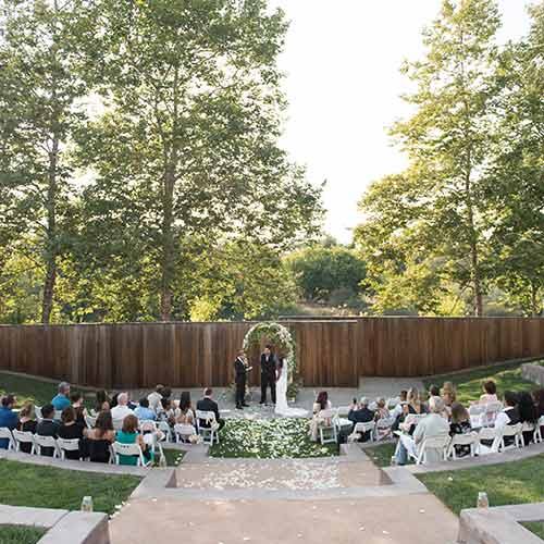 Wedding ceremony at the Jackson Family Wines Amphitheater at the CIA at Copia, an outdoor venue perfect for weddings and receptions in Napa, CA.