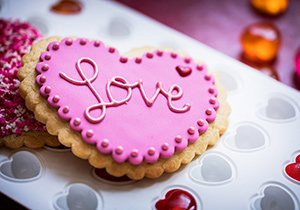 "heart-shaped ""love"" cookie"
